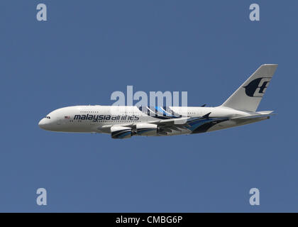An Airbus A380 wide-body, four-engine jet airliner in the livery of Malaysia Airlines flying at Farnborough International - Stock Photo
