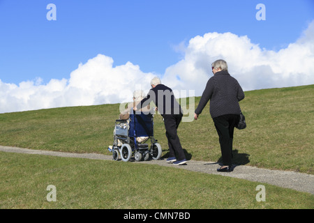 Elderly people take a walk in the countryside, Beachy Head, the South Downs National Park near Eastbourne, East - Stock Photo