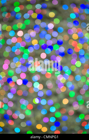 defocussed lights on a christmas tree - Stock Photo