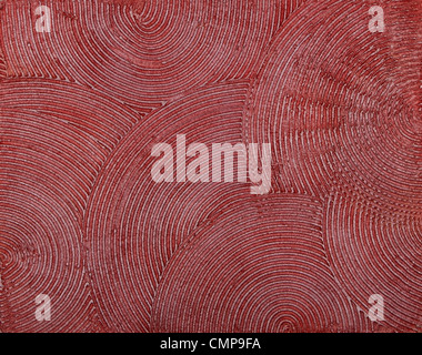 wall texture with a deep circular dabs of putty, covered with red paint. - Stock Photo