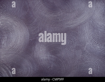texture of the walls covered with purple paint, with frequent, round, centric strokes. - Stock Photo