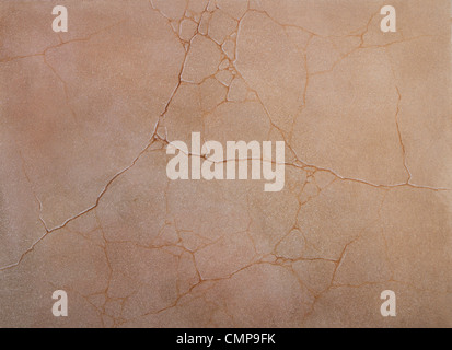 coarse texture of the cement cracked walls covered with pink paint - Stock Photo