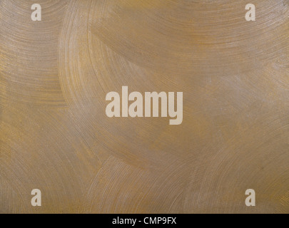 texture of a cement wall covered with metallic paint, with frequent, round, centric strokes. - Stock Photo