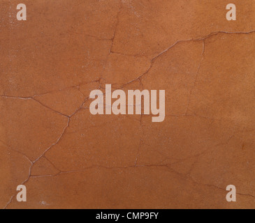 coarse texture of the cement cracked walls covered with brown paint - Stock Photo