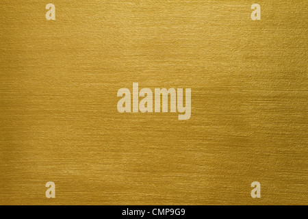 texture of a cement wall covered with gold paint with long strokes - Stock Photo
