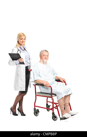 Full length portrait of a nurse or doctor posing next to a patient in a wheelchair isolated on white background - Stock Photo