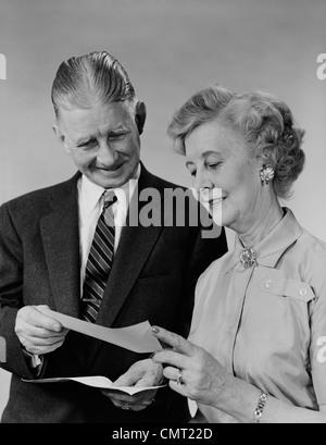 http://n450v.alamy.com/450v/cmt22d/1960s-senior-couple-man-woman-reading-holding-check-cmt22d.jpg
