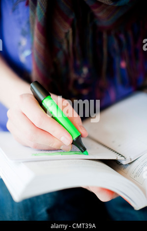 Close-up of woman marking in her book - Stockfoto
