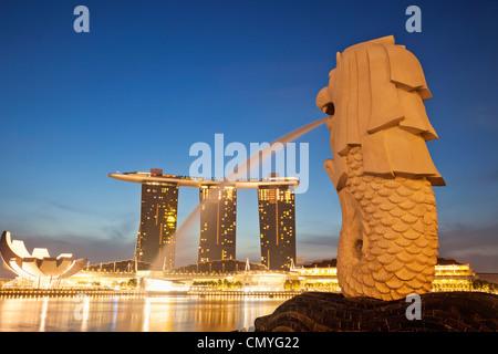 Singapore, Merlion Statue and Marina Bay Sands Hotel and Casino - Stock Photo