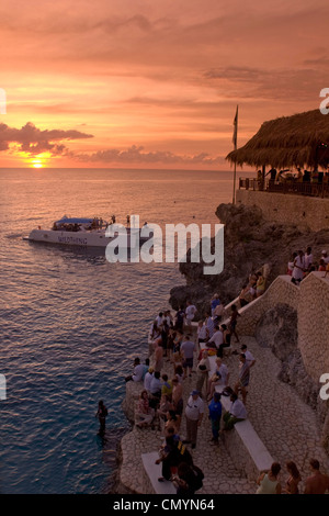 Jamaica Negril Rick´s Cafe open air bar viewpoint at sunset - Stock Photo