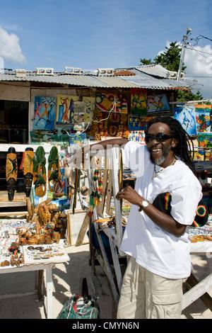 Jamaica Negril beach cool Rastafari man with souvenir shop - Stock Photo