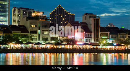 Skyline of Singapur, Boat Quay, Restaurant, bars at night, South East Asia, twilight - Stock Photo