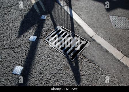 road surface, abstract, aiming, arrow, asphalt, avenue, backdrop, background, bitumen, black, building, bumpy, closeup, - Stock Photo