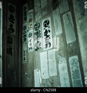 Japanese scrip on paper religious offerings - Stock Photo