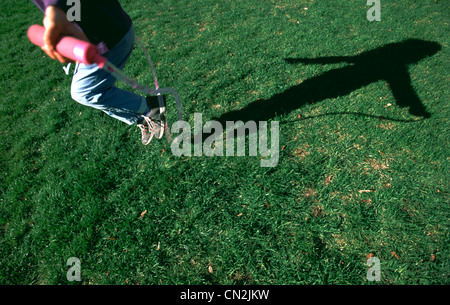 Young Girl Skipping Rope - Stockfoto