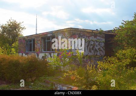 Graffiti on disused school building, London, UK - Stock Photo
