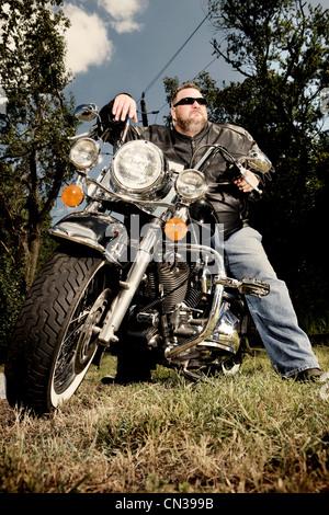 Portrait of a biker on motorcycle - Stock Photo