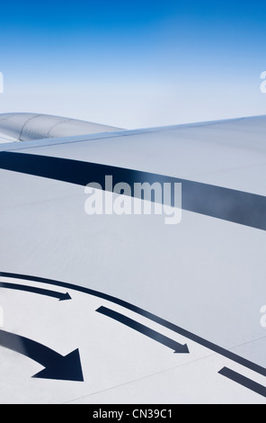 Airplane wing seen with arrows - Stock Photo