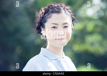 Young woman with plaited hair, portrait - Stock Photo