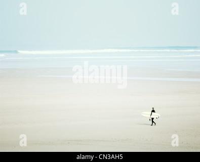 Surfer on beach - Stock Photo