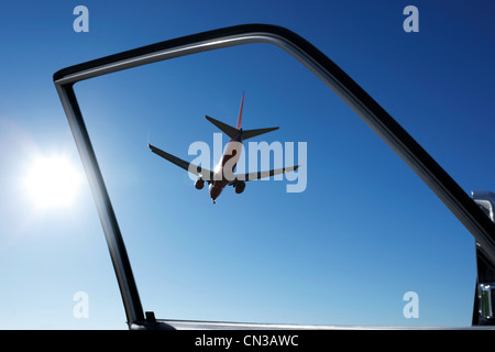 Car door with view of airplane - Stock Photo