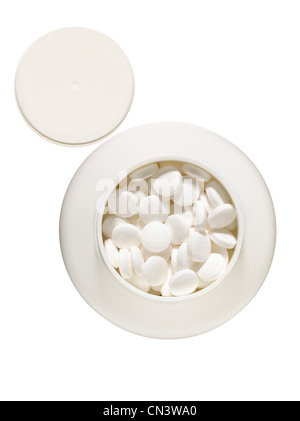 White pills in container - Stock Photo