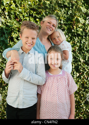 Family smiling together, portrait - Stock Photo
