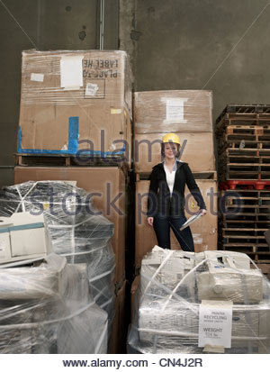 Woman in recycling warehouse - Stock Photo