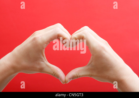Hands creating a heart - Stock Photo