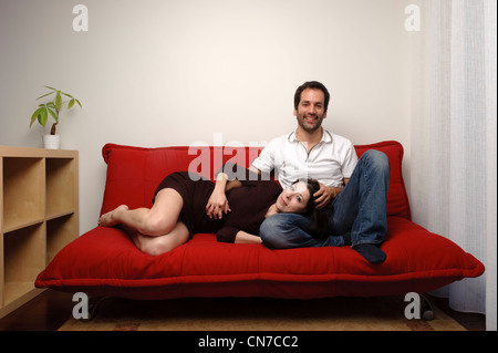 Teenage Couple In Love Cuddling On Carpet In Front Of