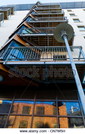 Balconies on new modern apartments, England, UK, with a reflection of old buildings in the glass - Stock Photo