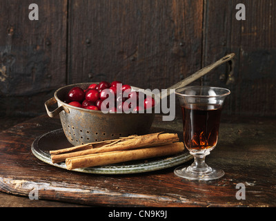 Cranberries, sherry, and cinnamon sticks - Stock Photo