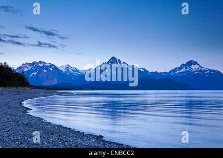View of Mount Wright seen from Goose Cove at dusk, Glacier Bay National Park & Preserve, Southeast Alaska, Summer - Stock Photo