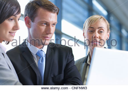 Close up of business people using laptop - Stock Photo