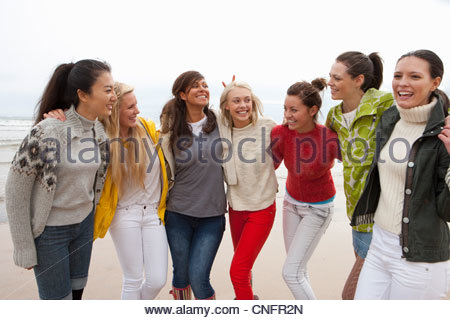 Smiling young women on beach - Stock Photo