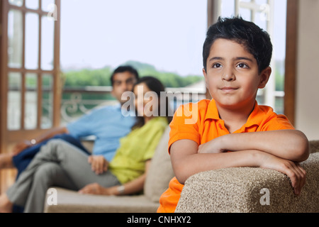 Young boy on a sofa - Stock Photo