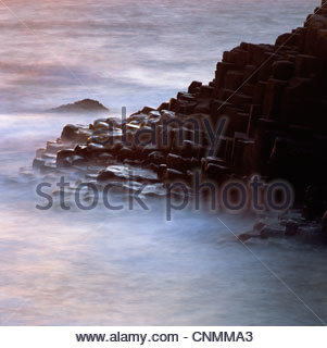Rock formations cloaked in fog - Stockfoto