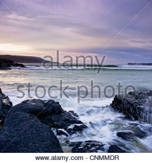Waves washing up on rock formations - Stock Photo