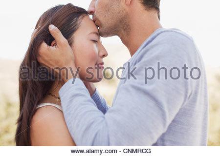 Close up of couple kissing - Stock Photo