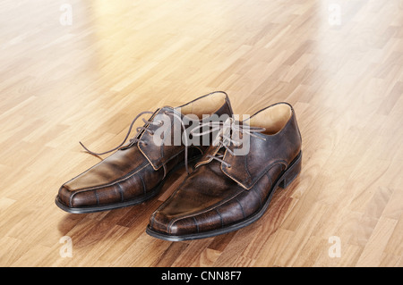 A pair of brown shoes in a home interior. - Stock Photo