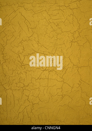 texture of a cement wall covered gold paint, with strokes. - Stock Photo