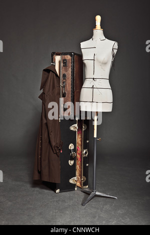 Mannequin and vintage trunks - Stock Photo