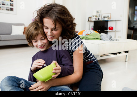 Mother and son relaxing in living room - Stock Photo