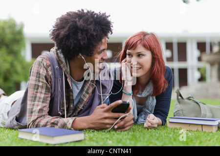 Students listening to mp3 player - Stock Photo