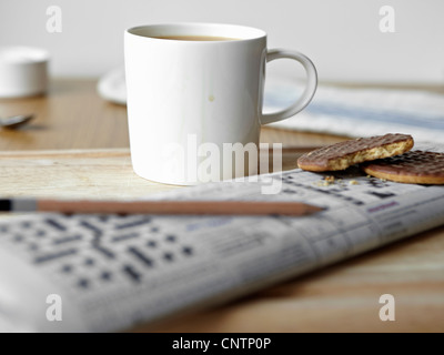 Tea, cookies and crossword on board - Stock Photo
