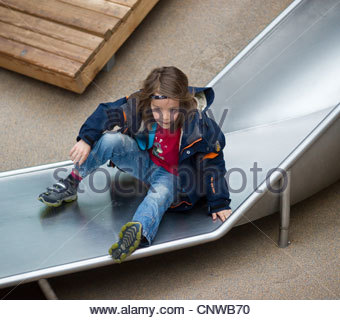 Young boy child slide playground children - Stock Photo