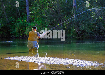 man fishing in Alnarko River, Canada, British Columbia, Bella Coola - Stock Photo