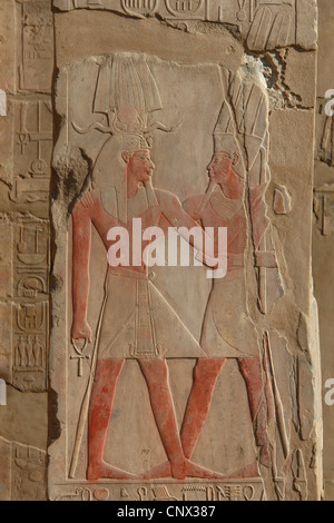 Pharaoh Amenhotep III and Amun Re. Relief in the Great hypostyle hall in the Karnak Temple Complex in Luxor, Egypt. - Stock Photo