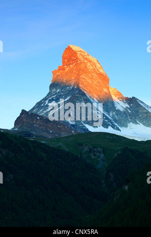 Matterhorn at sunrise with the top glowing in orange colour in the morning light, Switzerland, Valais - Stockfoto