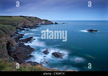 View from Lizard Point over rocky Polpeor Cove and onto the Lizard Lighthouse and old lifeboat Station, Lizard, - Stock Photo